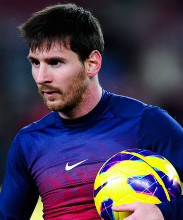 Barcelona's Lionel Messi leaves the pitch with ball after scoring four