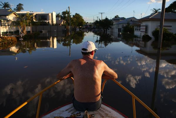 A resident looks on at a neighbourhood in Bundaberg during record flooding