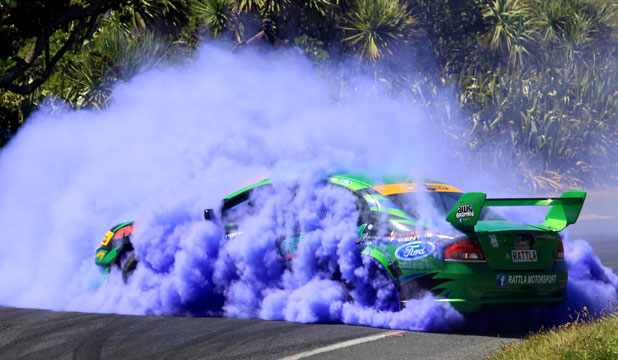 Reporter Hannah Fleming is somewhere amidst the billowing smoke with Waiuku driver Shane Allen in his Rattla Motorsport V8 Ford Falcon.