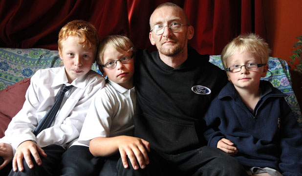 Three of Natasha Harris' eight children, from left Aidan Hodgkinson-Harris 12, Tyler 10, and Connor 8, with their father, Chris Hodgkinson.