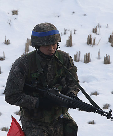 TENSIONS BUILD: A South Korean soldier participates in a military drills near the demilitarised zone separating North Korea from South Korea.