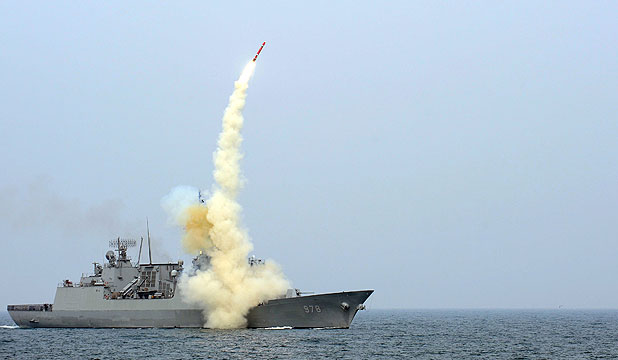 WEAPON OF WAR: A South Korean navy destroyer launches a new cruise missile during a drill.