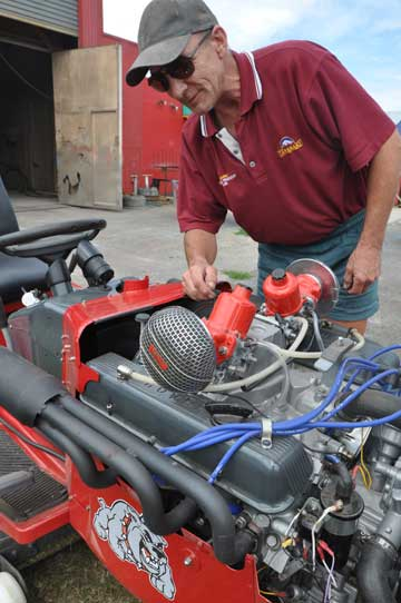 Colin Evans' V8 powered ride-on lawnmower is a roaring success