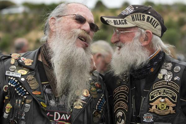 Mr Chips (left) and Rosco enjoy a catchup at the Harley-Davidson mass ride at the Ellerslie Event Centre to celebrate 110 years of the brand.