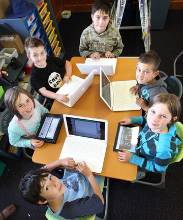 Tisbury School pupils, clockwise from bottom, Johannes Boersen 8, Chaneise Morgan-Fletcher, 10, Zahn Leti, 8, Geoffrey Perriam, 10, Chaise Hill, 10, and Brie Scott, 10, using computers in class. Many schools are struggling to afford technology and rely on school donations.