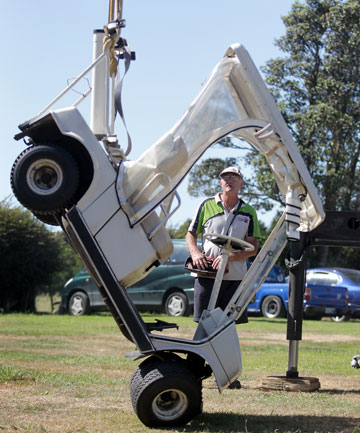 Manukorihi Golf Club committee member Peter Wills with a stolen golf cart which was taken for a joy-ride then dumped down a bank behind the golf course on Saturday night.