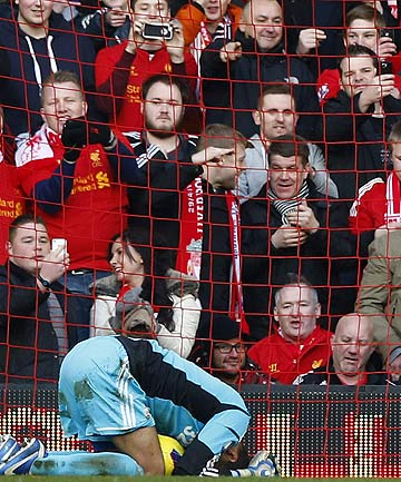 Swansea City's Michel Vorm reacts after Liverpool's fifth goal during their English Premier League match at Anfield in Liverpool.