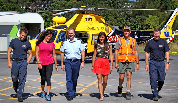 From left, crewman Phil Dwyer, Megan Stewart, Senior Constable Jeff McGrath, Lisa Tamati, LandSAR chairman Michael Johns and pilot Stephen Beck gear up for the Mokau Half Marathon in April.
