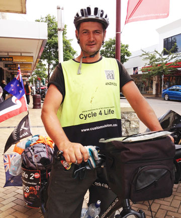 Dean Connolly is riding his bike around New Zealand to raise awareness for children's charities.