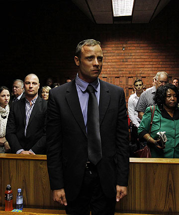 FELT 'HORROR AND FEAR': Oscar Pistorius awaiting the start of proceedings in the Pretoria Magistrates Court.