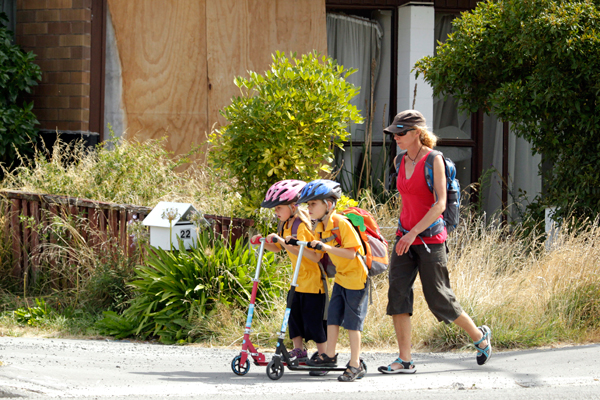 Life goes on: Lisa Cobb walks her children, Phoebe and Felix, home from school.