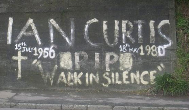 FANS' GRIEF: The Ian Curtis Memorial Wall in Wallace St, Wellington, before council workers painted over it.