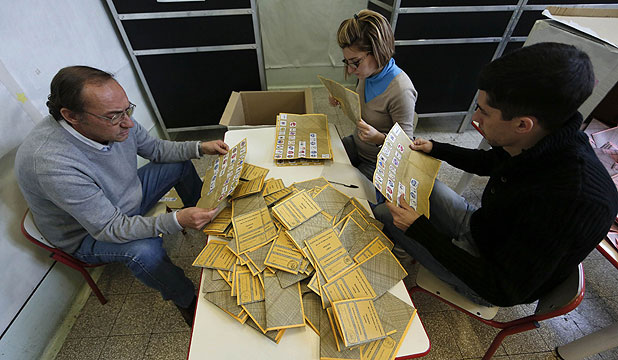 LEFT IN DEADLOCK: Voting officials count the ballots in a polling station in Rome.