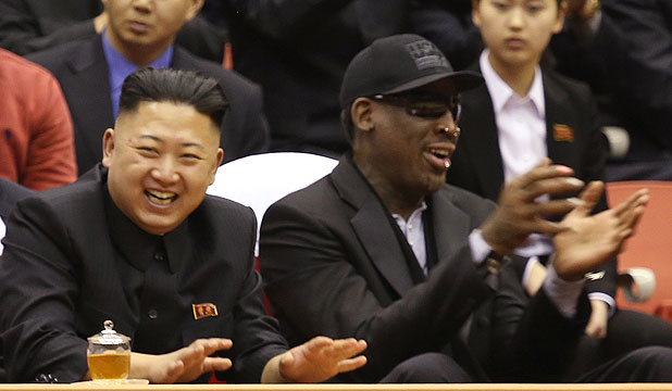 North Korean leader Kim Jong Un (left) and former NBA star Dennis Rodman watch an exhibition basketball game at an arena in Pyongyang.