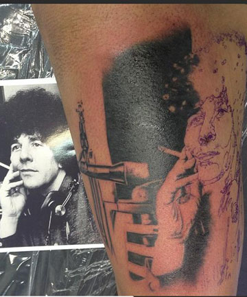 Millie Elder got this tattoo of her father, Sir Paul Holmes, on her leg at an Auckland tattoo parlour this week.