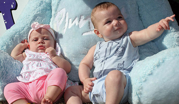KICKING BACK: Plunket babies Sadie-Ray De-Alwis, 19 weeks, and Clarke Ballinger-Jedd, four months, relax with Plunket bear Big Blue.