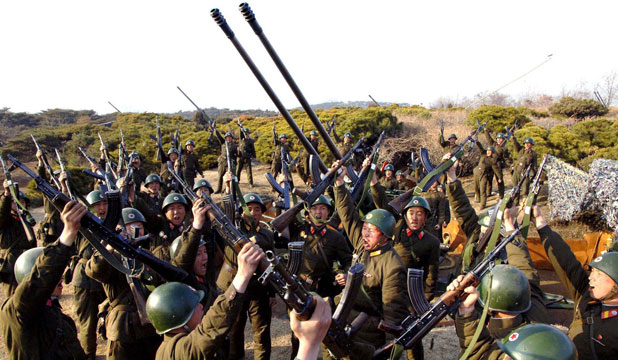 GEARED FOR WAR: North Korean soldiers attend military drills in a photo released by the North's official KCNA news agency.