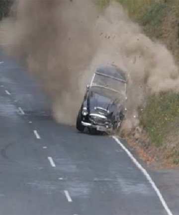 A screen grab from the video of Bernie Huynen's 1962 Austin Healey crashing into a bank on a hill climb event in Wellington.