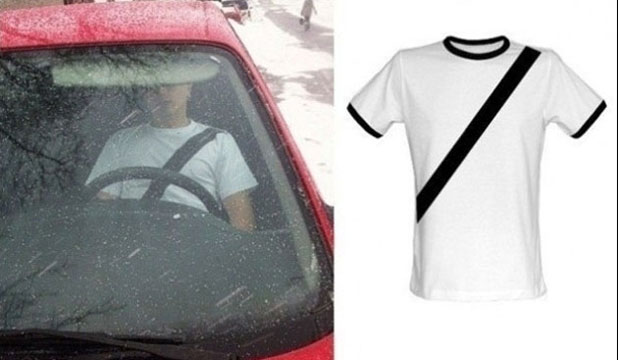 Motorist wears a seatbelt t-shirt.