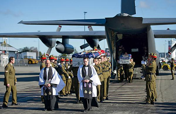 Soldiers bodies carried off the plane
