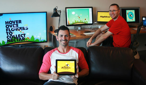 Flightless creative director John O'Reilly, left and technical director Greg Harding with screenshots of their iPhone app Bee Leader.