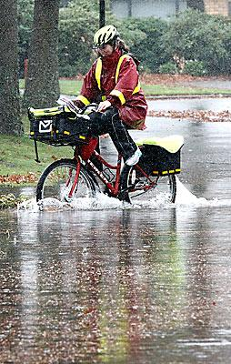 Postie in flooded Villa Grove