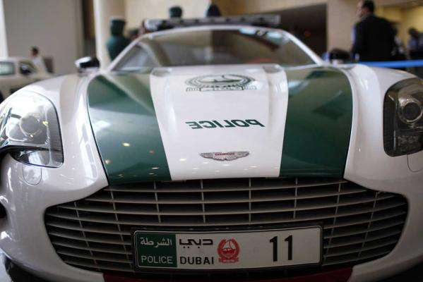 An Aston Martin car used by Dubai police is seen at the Arabian Travel Market exhibition in Dubai.