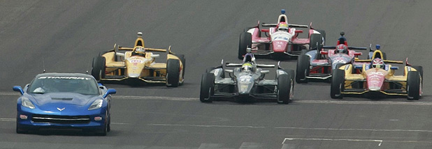 Brazil's Tony Kanaan follows the pace car as he wins under a yellow flag in front of Carlos Munoz of Colombia (26) and Hunter-Reay of the US (1) during the 97th running of the Indianapolis 500.