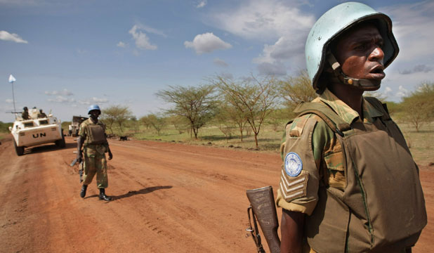 Soldiers from Zambia serving with the international peacekeeping operation patrol on the ground in the region of Abyei, central Sudan
