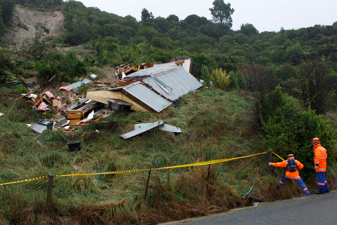 A hillside home above Sandy Bay after the collapse that killed the occupant.
