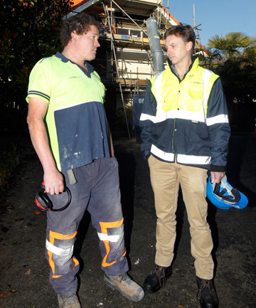 Corbel Construction director Craig Jones, right, with British worker Micky Read at an Opawa residential construction site.