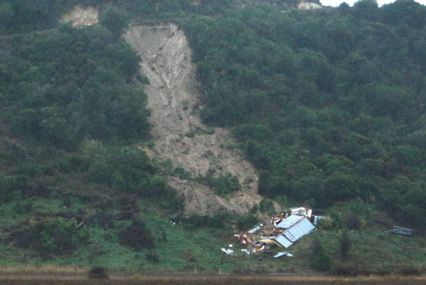 The hillside home above Sandy Bay that collapsed during a slip on Sunday.