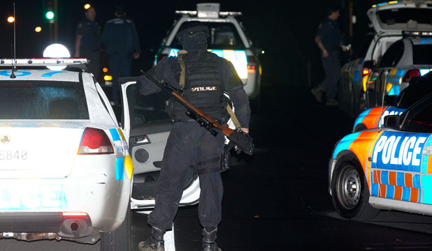 Armed Offenders Squad members stand down after a bank siege in Penrose, Auckland.