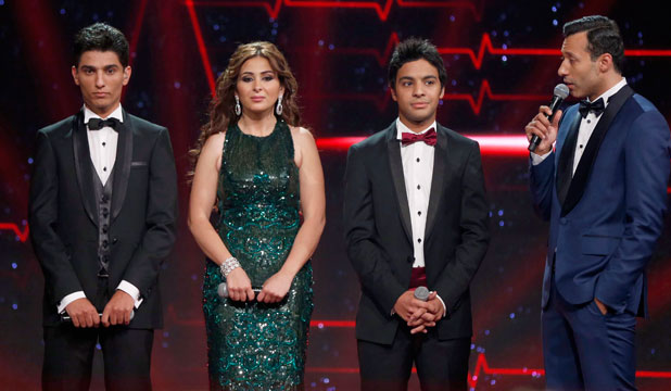 Palestinian Mohammed Assaf, left, Syrian Farah Yousef and Egyptian Ahmed Jamal wait for the results as they stand on stage during the Season 2 finale of Arab Idol.
