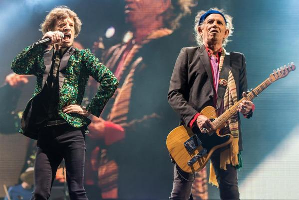 Sir Mick Jagger (left) and Keith Richards of The Rolling Stones performs on the Pyramid Stage during day three of the 2013 Glastonbury Festival at Worthy Farm.