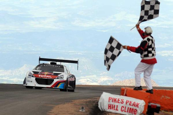 Sebastien Loeb, of France,  powers his Peugeot 208 T16 Pikes Peak across the finish line to set a record time of 8:13.87 in the Pikes Peak International Hill Climb in Colorado Springs, Colorado.
