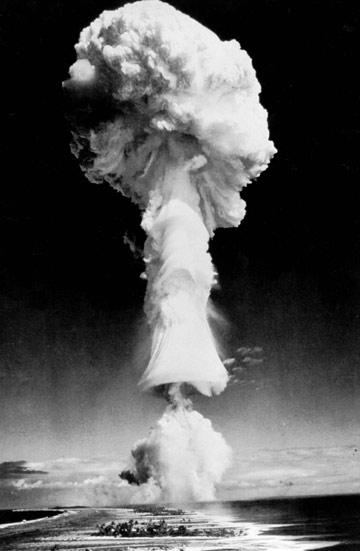 A mushroom cloud forms over the South Pacific atoll of Mururoa during one of numerous atmospheric tests France conducted in the region between 1966-1974.