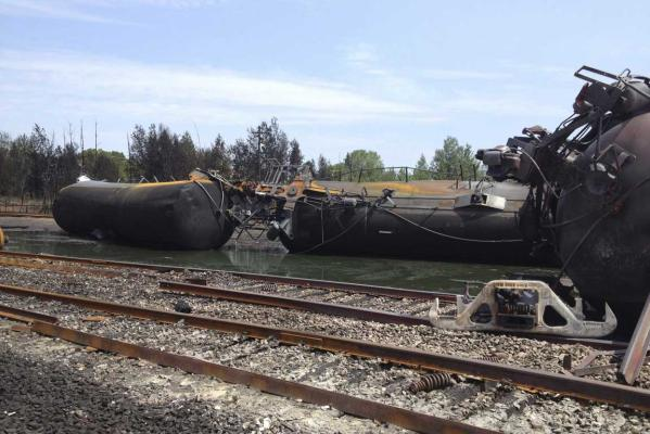 Burnt train cars are seen after a train derailment and explosion in Lac-Megantic, Quebec July 8, 2013, in this picture provided by the Transportation Safety Board of Canada.
