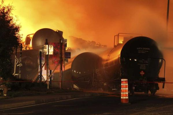 First responders fight burning trains after a train derailment and explosion in Lac-Megantic, Quebec early July 6, 2013 in this picture provided by