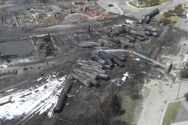 An aerial view of burnt train cars after a train derailment and explosion in Lac-Megantic, Quebec July 8, 2013 in this picture provided by the Transportation Safety Board of Canada.