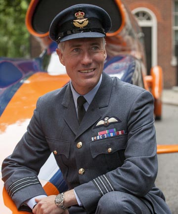 British Royal Air Force Wing Commander, Andy Green poses next to the super sonic car, Bloodhound SSC at Downing Street, London, on June 24, 2013.
