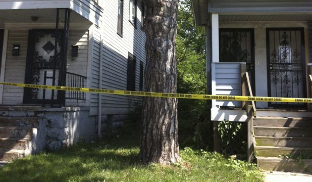 Two homes where female bodies were found wrapped in plastic bags have been taped off by police with crime scene tape in East Cleveland, Ohio.