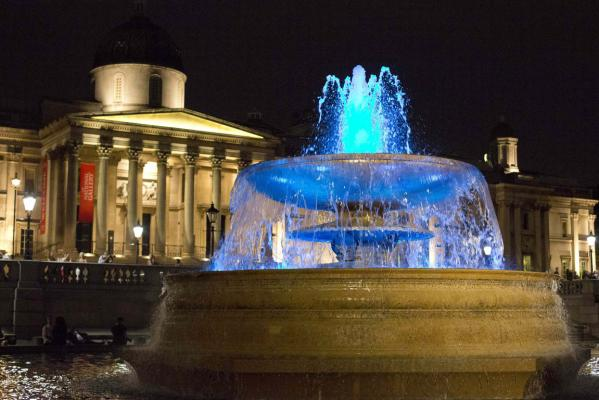 The fountains at Trafalgar Square, London, are lit up by blue lights to signify the birth of a baby boy to Britain's Prince William and Catherine, Duchess of Cambridge in London.