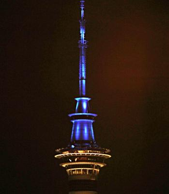 Auckland's Sky Tower turns blue to celebrate the arrival of the royal baby.