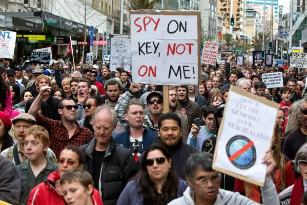 A crowd marches down Auckland's Queen St to protest the GCSB spying bill