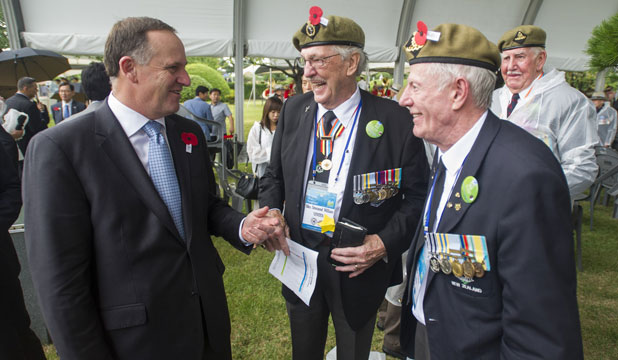 Prime Minister John Key chats to veterans Max Vinten and Charles Sibun.