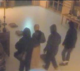 A CCTV image of the three men police believe were involved in a 'nasty' attack on a Buddhist monk, second from left.
