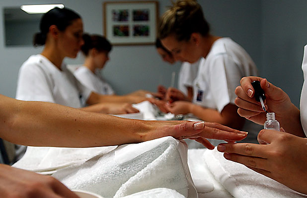 NaSA students perform manicures on one another