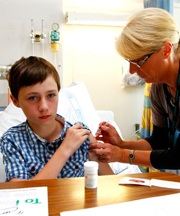 Jack McDaid, 12, doesn't  flinch as he gets his flu injection from Waikato DHB clinical nurse co-ordinator Kim Hunter