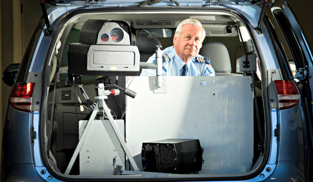 Sergeant Bruce Lumsden and speed camera